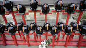 Mine helmets and painted crosses sit at the entrance to Massey Energy's Upper Big Branch coal mine April 5 in Montcoal, W.Va. The memorial represents the 29 coal miners who were killed in an explosion at the mine a year ago.