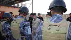 Maj. Gen. Claudio Angelelli addresses oil police recruits after their first  run-through exercise to clear a building of hostage-takers. Angelelli is the  commander of the Italian Carabinieri unit in Iraq that is training the oil  police.