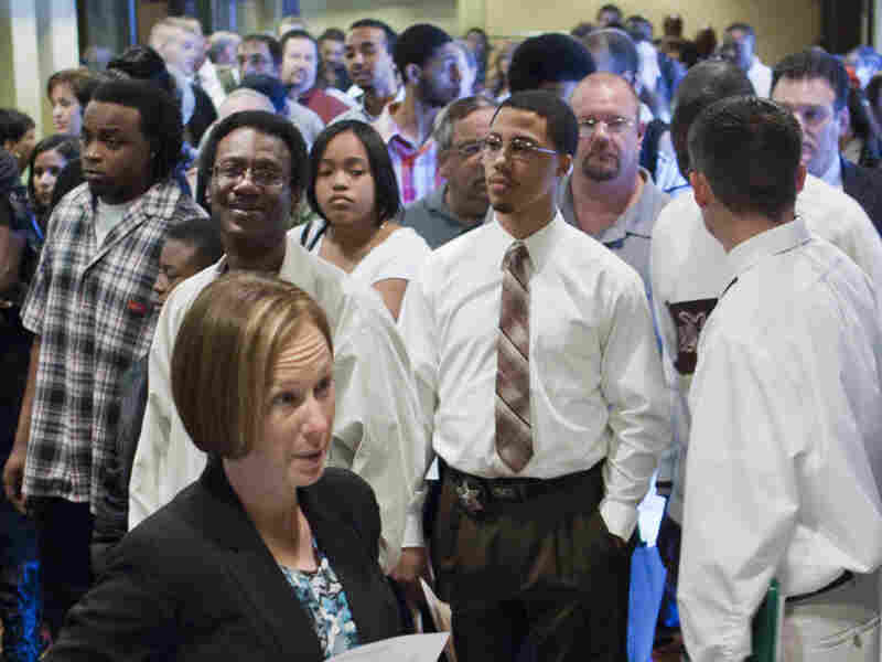 Job seekers arrived early to a job fair in Omaha, Neb. Many of America's largest employers have employee referral programs to help find the right people.