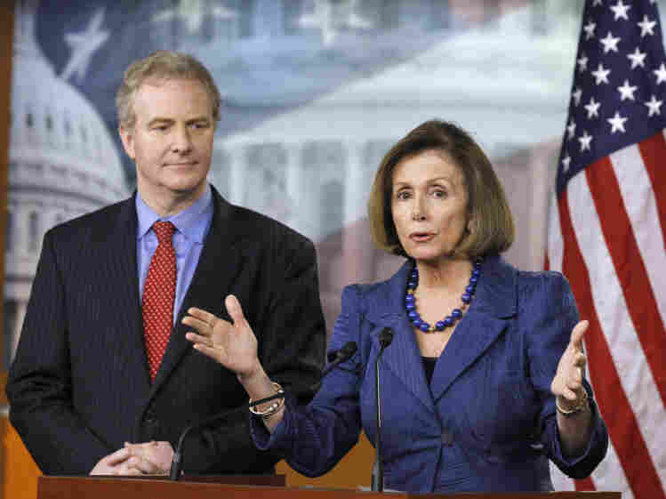 House Minority Leader Nancy Pelosi (D-CA), accompanied by Rep. Chris Van Hollen (D-MD), ranking member on the House Budget Committee, gestures Thursday during a news conference on Capitol Hill.