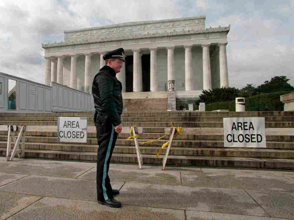 U.S. Park Service Police Officer P.G. Carroll stood in front of closed signs at the Lincoln Memorial in Washington Wednesday, Nov. 15, 1995, as the partial shutdown of the federal government continued. Hundreds of thousands of government workers were laid off as President Clinton and the Republican Congress remained at odds over budget priorities.