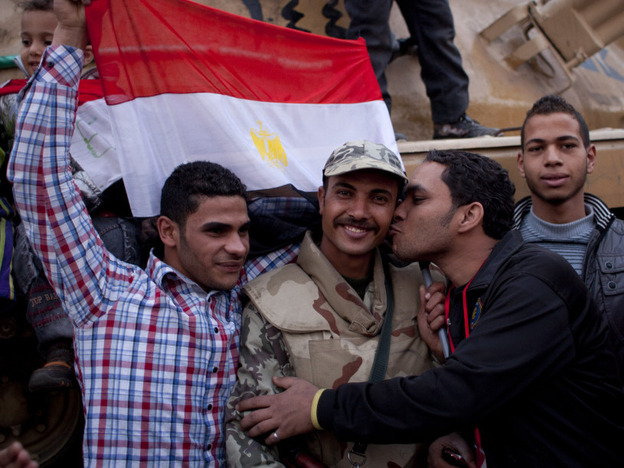 An anti-government protester kisses an army soldier during celebrations in Cairo's Tahrir Square on Feb. 12, after President Mubarak stepped down. Now, the revolution's leaders say the army is continuing the repressive practices of the former regime.