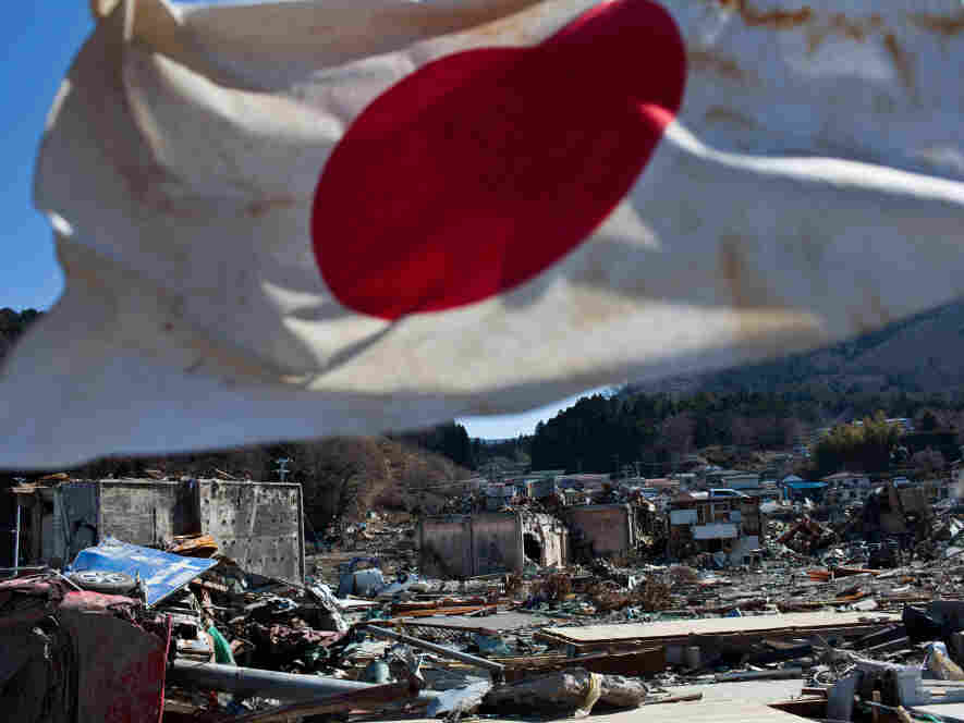 A Japanese flag waved Wednesday over the the wreckage and devastation in Onagawa, Miyagi prefecture.