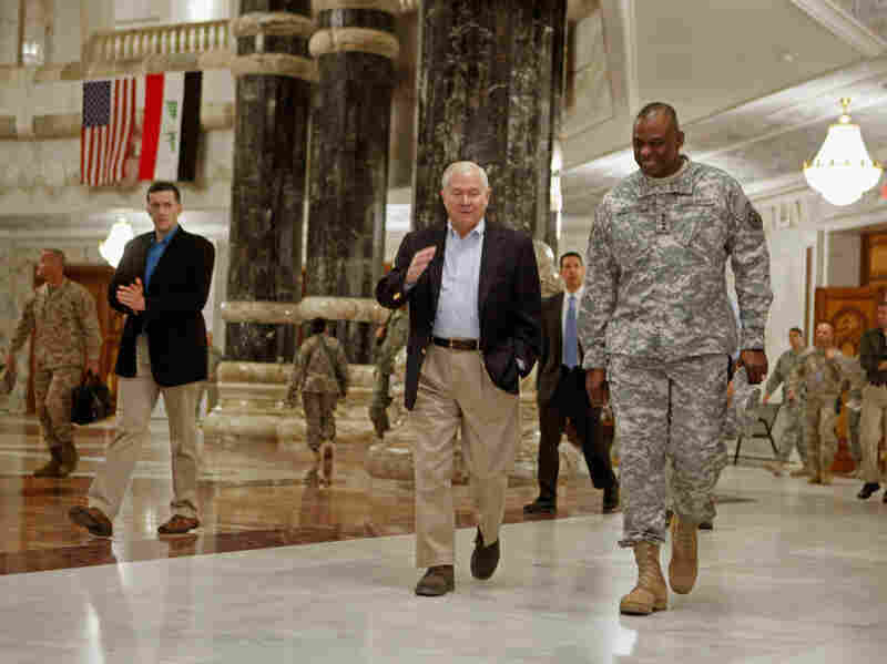 Gates (center) and Gen. Lloyd Austin (right), commander of U.S. forces in Iraq, arrive for a meeting at the Al Faw Palace.