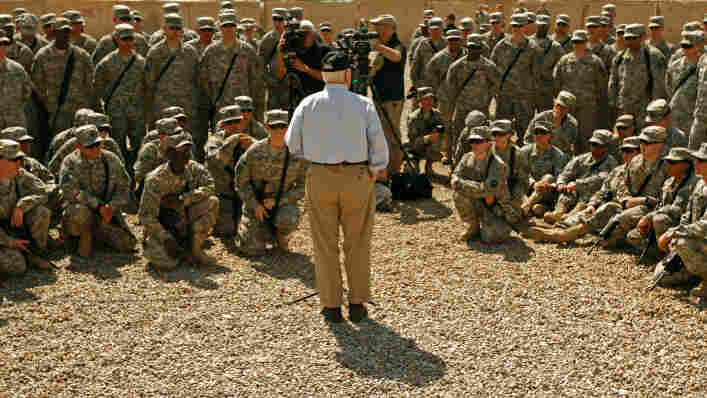 U.S. Defense Secretary Robert Gates talks with troops from the U.S. Army 25th Infantry Division from Hawaii during a visit at Camp Victory in Baghdad on Thursday.