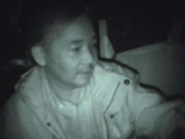 A screengrab from a video released on April 7, 2011 by the French military officials shows Japanese Ambassador Okamura Yoshifumi being evacuated from his home in Abidjan.
