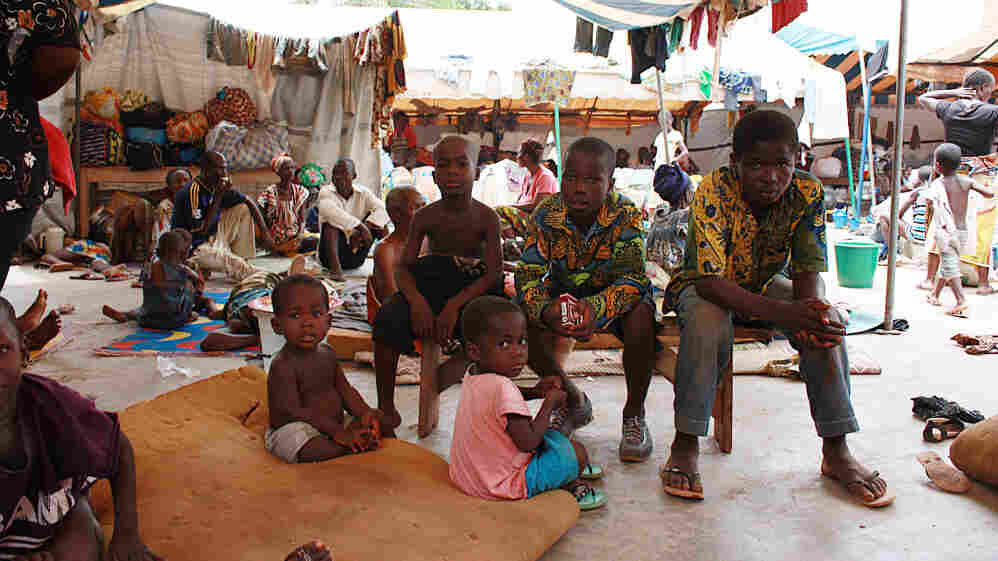 Ivorian displaced families sit at a UNHCR camp for displaced people west of Abidjan, on April 6, 2011.