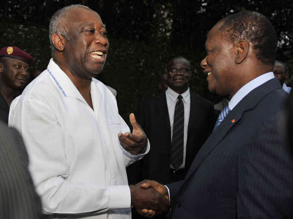 Ivory Coast's then-president, Laurent Gbagbo, meets with rival Alassane Ouattara in May 2010, six months before the elections that would split the country. Now Gbagbo is holed up in a bunker, surrounded by forces loyal to Ouattara, the president-elect.