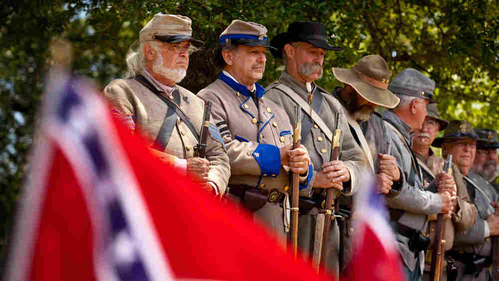 Magnolia Cemetery in Charleston, S.C., is the resting place of more than 2,000 Confederate soldiers. Above, Civil War re-enactors mark Confederate Memorial Day last year at the cemetery. As the 150th anniversary of the start of the war approaches, there are fears that the commemorations will rekindle old hatreds.