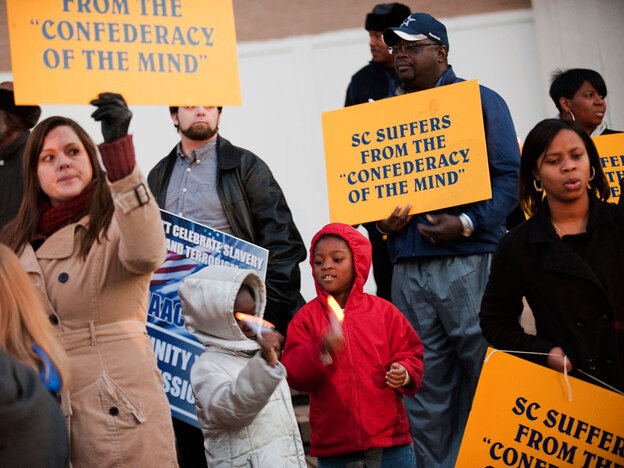 Members of the Charleston branch  of the NAACP gather in December 2010 to protest a Secession Ball commemorating  South Carolina's decision to secede.