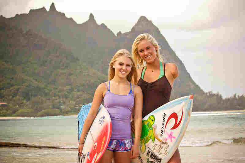 """AnnaSophia Robb (left) portrays Hamilton in the new film, Soul Surfer. As a Colorado native, Robb didn't have much surfing experience, so Hamilton showed her the ropes. """"I wanted her to at least look like she could surf ... and then I came in for some stunt-surfing,"""" Hamilton says."""