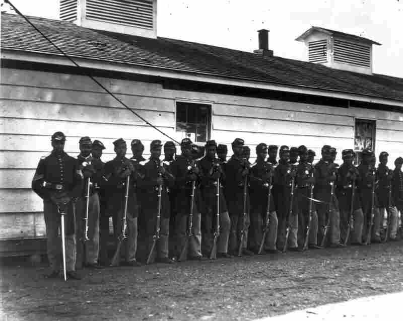 By 1865, when this photograph was taken, African-Americans were signing up in record numbers, prompted in part by 1863's Second Battle of Fort Wagner. In that battle, a black infantry regiment, the 54th Massachusetts, fought in an unsuccessful assault on a Confederate bastion. The heroism of the unit became national news, and convinced the Union to begin recruiting black soldiers in greater num...
