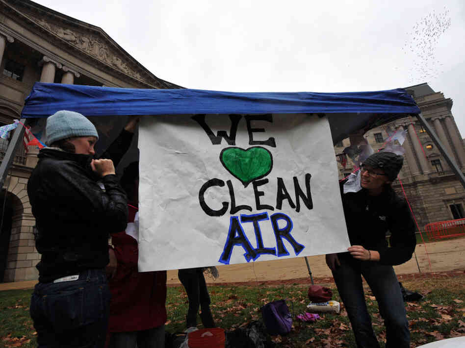 Environmental activists display placards during a demonstration in front of the Environmental Protection Agency in December, urging campuses to abandon coal in favor of clean and renewable energy sources. The GOP is currently pushing for the EPA to be banned from issuing greenhouse gas regulations.