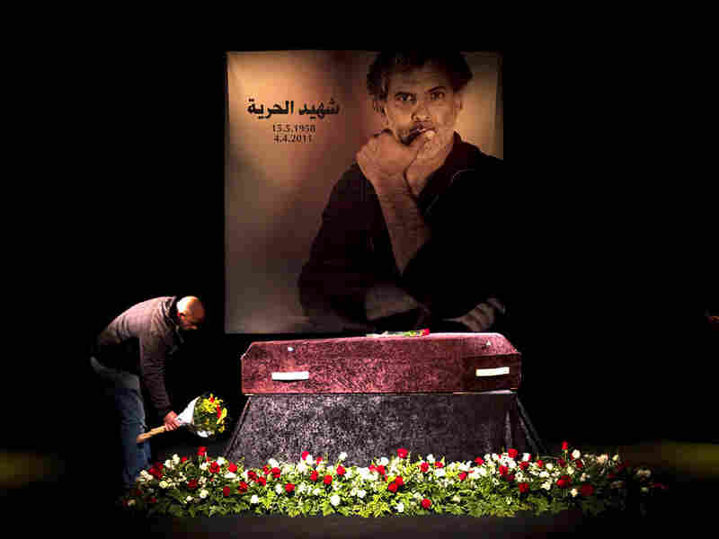 A man lays flowers on the coffin of Arab-Jewish actor,  theater director and political activist Juliano Mer Khamis at The Almidan  Theatre in Haifa, north of Israel, on Apr.  6.