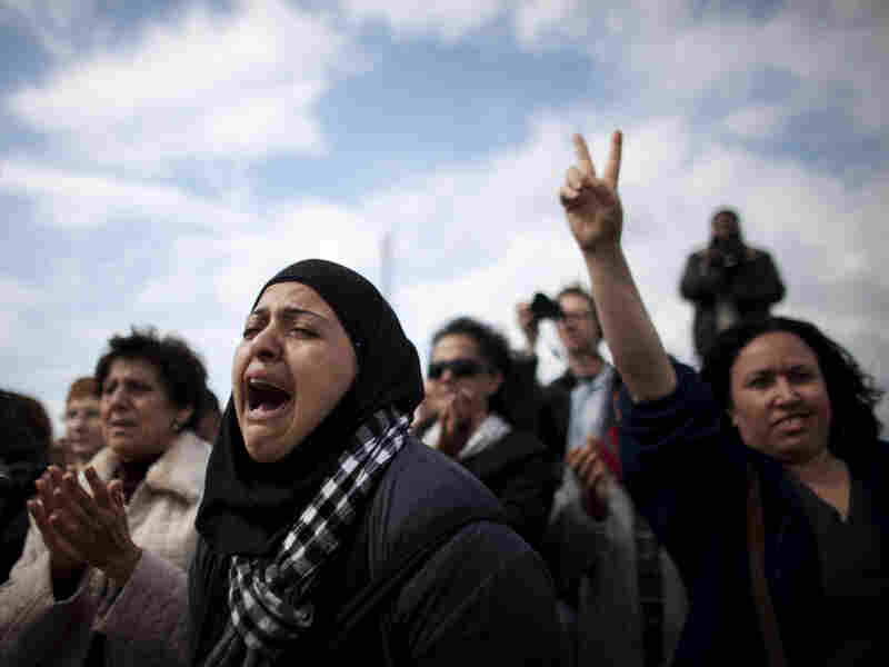 An Israeli-Arab woman mourns Juliano Mer-Khamis  during his funeral procession on the Israeli side of the Jalama  checkpoint near the West Bank town of Jenin on Apr. 6.