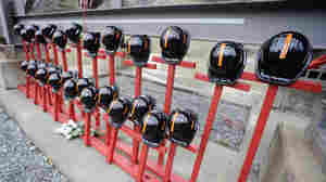 Mine helmets and painted crosses sit at the entrance to Massey Energy's Upper Big Branch coal mine, a memorial to the 29 miners killed in an explosion April 5, 2010.