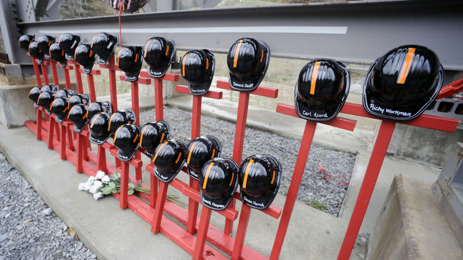 Mine helmets and painted crosses sit at the entrance to Massey Energy's Upper Big Branch coal mine, a memorial to the 29 miners killed in an explosion April 5, 2010. (AP)