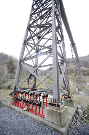 Mine helmets and painted crosses sit at the entrance to Massey Energy's Upper Big Branch coal mine Tuesday in Montcoal, W.Va. The memorial honors the 29 coal miners who were killed in an explosion at the mine April 5, 2010.