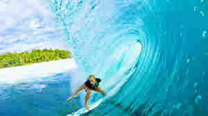 In 2003, 13-year-old surfing phenom Bethany Hamilton lost her left arm in a terrifying shark attack. Undeterred, Hamilton won her first national title in 2005, and went pro in 2007. She is pictured above in 2008, surfing in Mentawai, Indonesia.