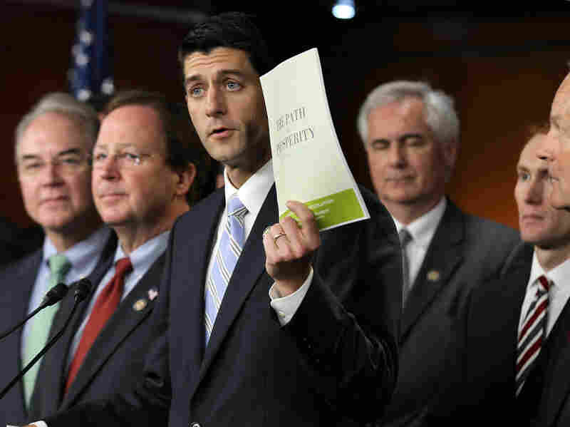Flanked by other congressionial members, Rep. Paul Ryan holds up a copy of the 2012 Republican budget proposal during a news conference this week. Ryan's budget plan includes an overhaul of Medicare.