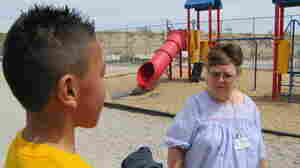 Lead counselor Susan Crews speaks with children at an elementary school in El Paso.