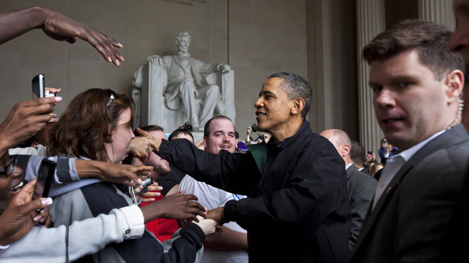 Barack Obama shakes hands with tourists visiting the Lincoln Memorial in Washington, D.C., Saturday during a surprise visit a day after budget negotiations with Congress prevented a government shutdown.