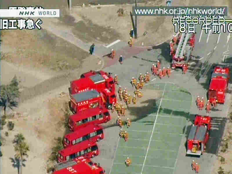 A screen grab from Japanese public broadcaster NHK shows a fleet of firetrucks preparing to cool the quake-hit nuclear plant in the town of Okuma in Fukushima prefecture on March 19.