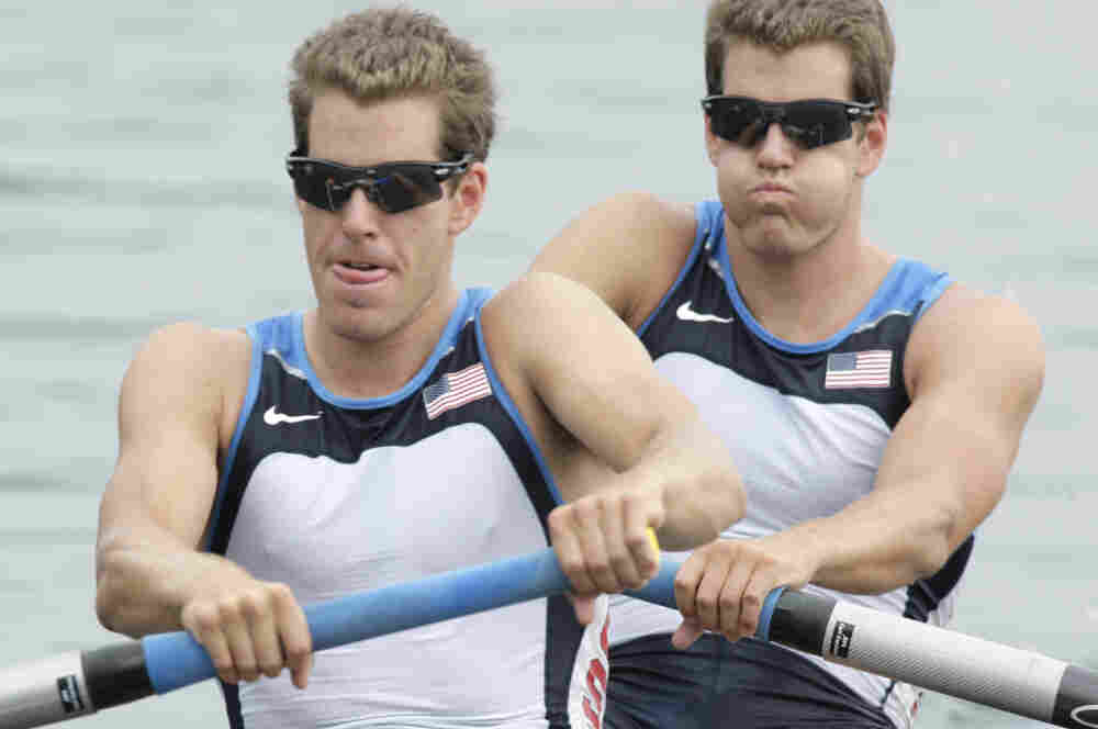 Cameron Winklevoss, left, and twin brother Tyler take the start of the Men's pair repechage  at the Beijing 2008 Olympics.