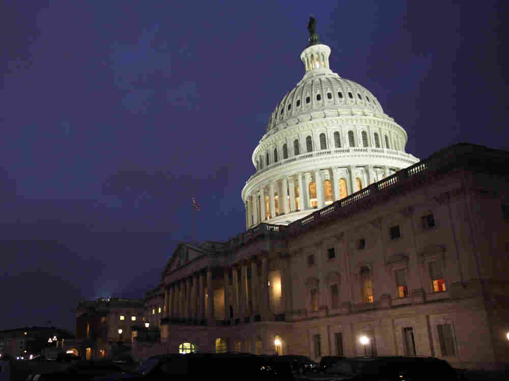 The U.S. Capitol building  illuminated Friday evening, as Congress worked inside to reach a budget  compromise and avert a government shutdown.