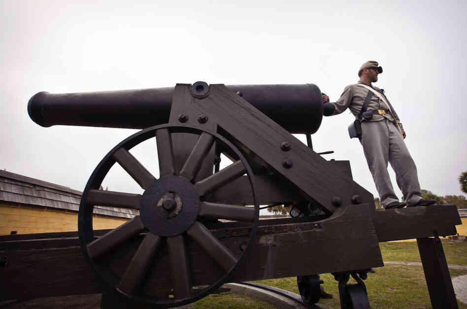 A Confederate re-enactor readies an authentic Civil War cannon Saturday at