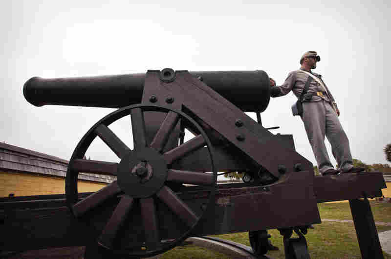 A Confederate re-enactor readies an authentic Civil War cannon Saturday at Fort Moultrie in South Carolina.