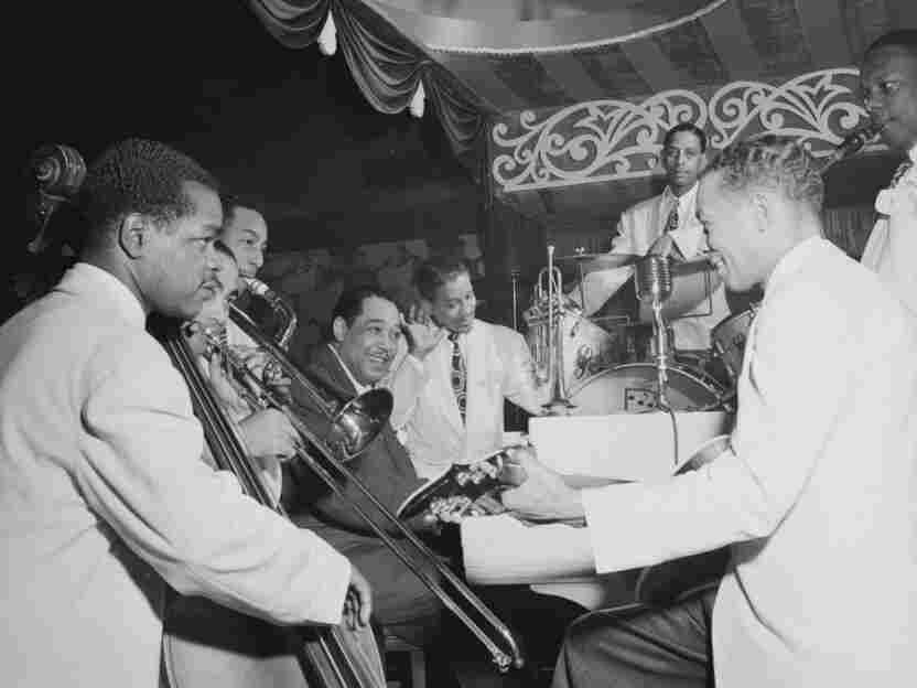 Duke Ellington (left of center) poses with some of his sidemen in 1946, including Junior Raglin, Lawrence Brown, Johnny Hodges, Ray Nance, Sonny Greer, Fred Guy and Harry Carney.