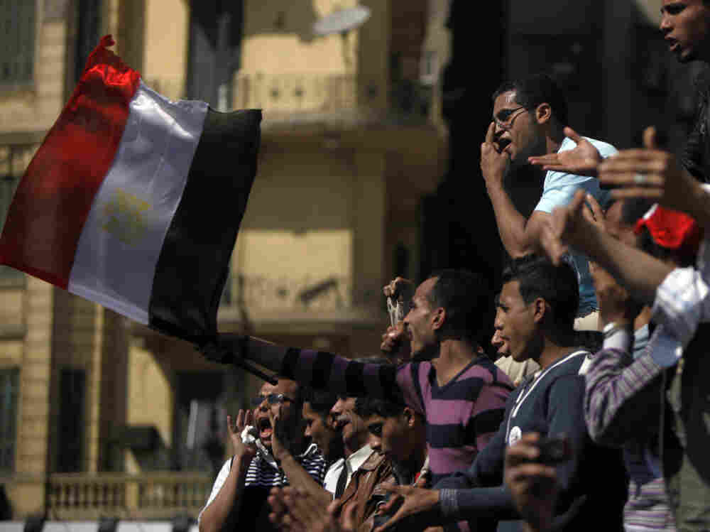 Many Egyptians have continued to gather in Cairo's Tahrir Square to demand reform. These men were there Sunday.