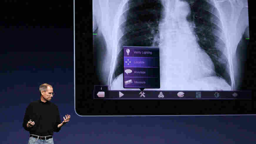 Apple CEO Steve Jobs describes the company's new iPad 2 on stage at the Yerba Buena Center for the Arts in San Francisco.