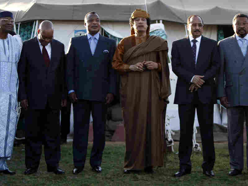 Libyan leader Moammar Gadhafi (third from right) stood with five delegates of the African Union after negotiations Sunday at his Bab al-Aziziya compound in Tripoli. From left: Presidents Amadou Toumani Toure of Mali, Jacob Zuma of South Africa, Denis Sassou Nguesso of Congo and Mohamed Ould Abdel Aziz of Mauritania, and African Union Commission Chairman Jean Ping.