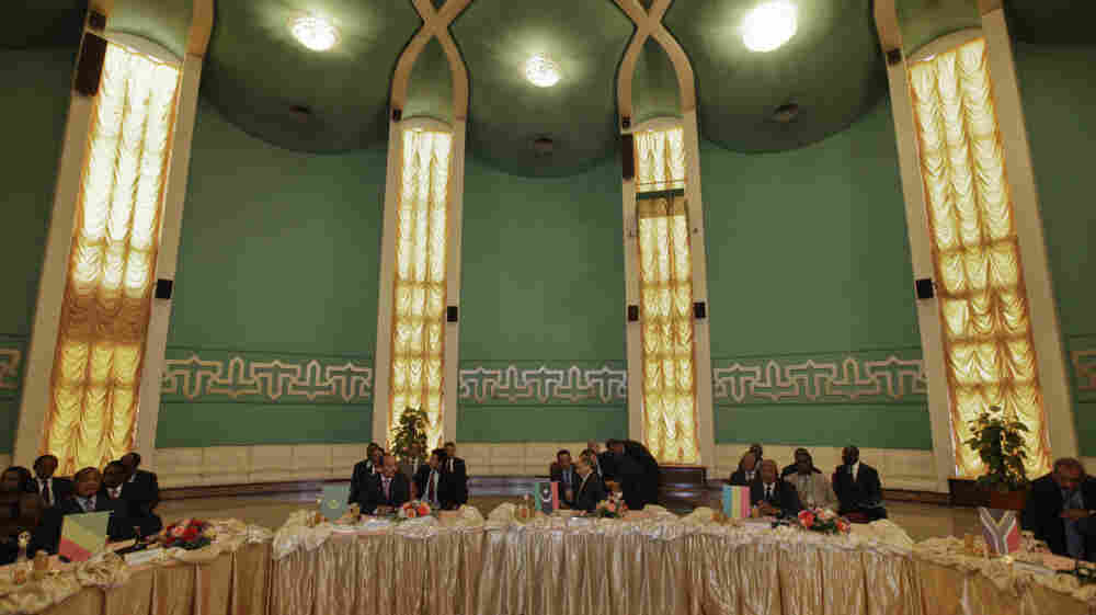 African Union delegates met with Libyan opposition leaders Monday at the Tibesty Hotel in Benghazi. Hundreds of people demonstrated outside the negotiations, saying there can be no peace in Libya until Moammar Gadhafi is gone.