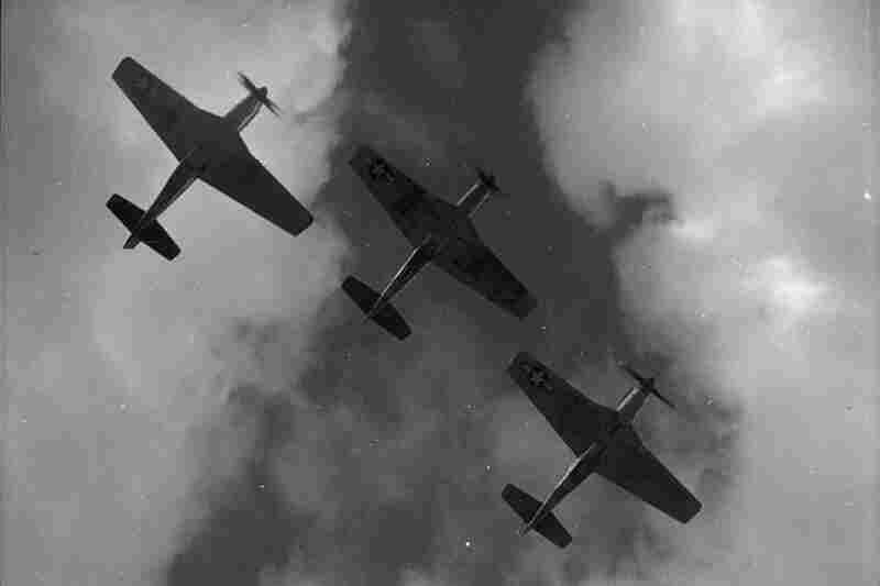 Three P-51 Mustangs fly in formation over Ramitelli, Italy, in March 1945. The Red Tails got their nickname from the distinctivebright red paint on the Mustangs' tails and noses.