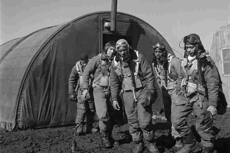 A group of Tuskegee Airmen exit the parachute room in Ramitelli.