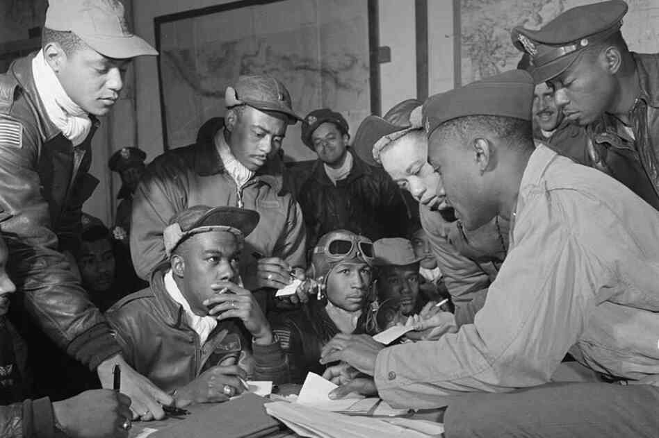 Hiram Mann (third from left) was a member of the elite Red Tail pilots of the Tuskegee Airmen. Here, he's shown with his fellow airmen at Ramitelli Air Base in Italy in March 1945. That month, the Red Tails escorted Allied bombers from Ramitelli to Berlin, the longest mission in the European theater.