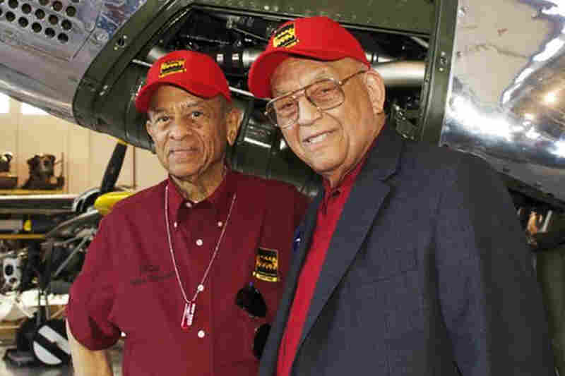 "Harry Stewart (left) and Robert Friend at the Red Tail reunion in Orlando, Fla., in March. Stewart shot down three German fighter planes in one day, and later won a much-coveted Top Gun contest. More than 60 years ago, he went to Friend's house for dinner, and as he puts it, ""Dinner was so much fun, I married his sister."""