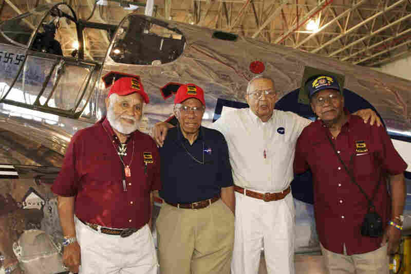 "Leo Gray (from left), Thurston Gaines, John Lyle and William E. Rice stand in front of a P-51C Mustang. Gray organized the reunion, bringing together men who hadn't seen each other for more than 60 years. ""The youngest one of us is, what, 85? 86?"" he said. ""So I wanted to do this before another one of us died."""
