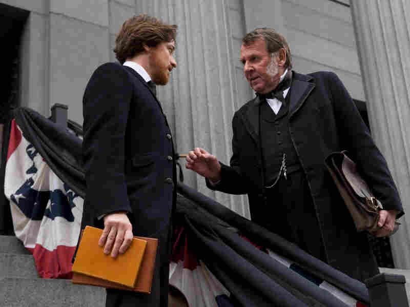 Tom Wilkinson (right) plays a Maryland senator whose own political liabilities keep him from defending Surratt — and who recruits McAvoy's Aiken to do the job.