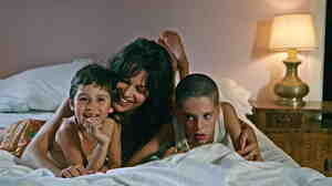 Life was 'Beautiful': A carefree mother (Micaela Ramazzotti, center), an angry father and the string of men who succeed him make for a chaotic childhood for Bruno (Giacomo Bibbiani, right) and his sister Valeria (Aurora Frasca).
