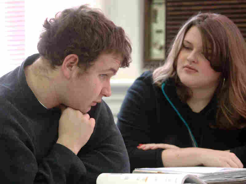 Lowell Austin, an autistic student at Marshall University in Huntington, W.Va., receives tutoring from Stephanie Hurly at the university's Autism Training Center, one of several college programs highlighted on the website College Autism Spectrum.