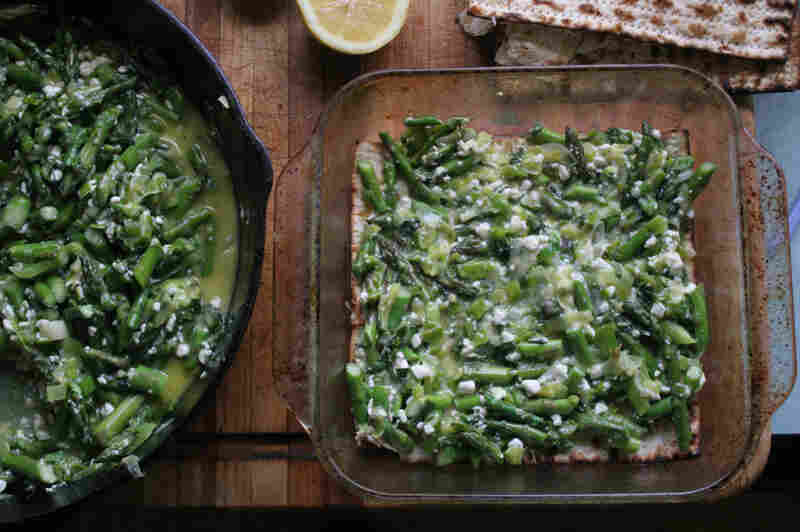 The prepared leek-and-asparagus filling is spread between layers of water-dampened matzo.