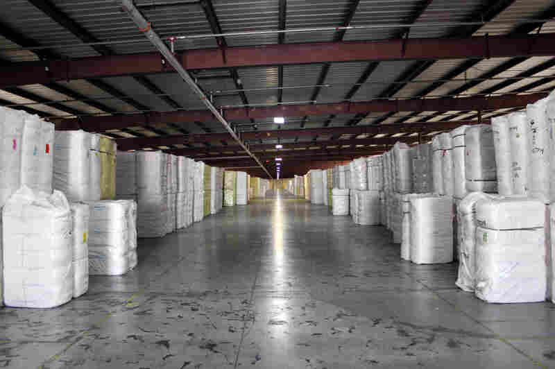 Bales of ginned cotton sit in a warehouse in Kansas. A shortfall in cotton production in China and India has led to a rise in U.S. production.