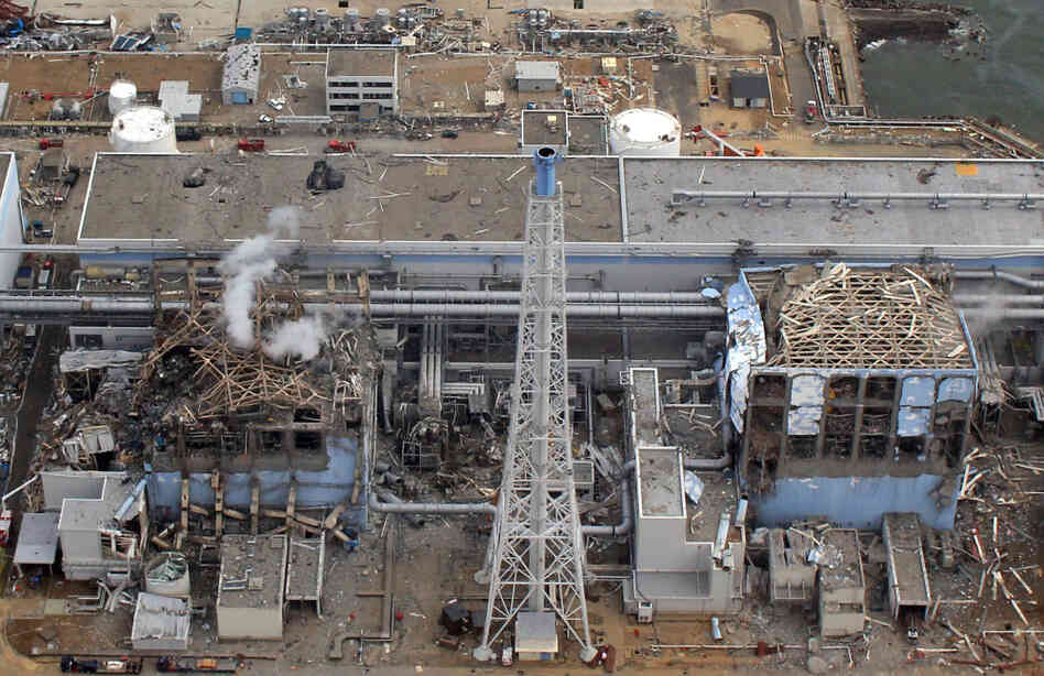 The Fukushima Dai-Ichi plant Reactor Numbers Three and Four on March 20, 2011. Smoke rises over Three.