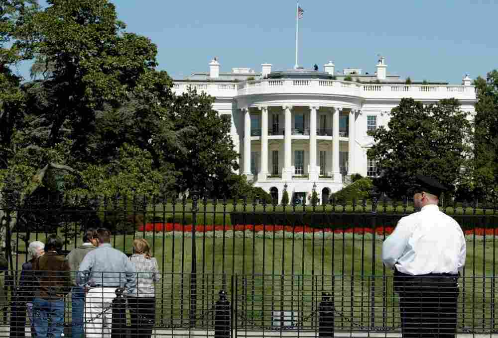 A Secret Service Officer stands guard outside of the White House.