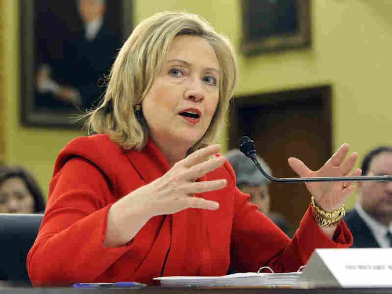Secretary of State Hillary Clinton testifies about the State Department's budget during a hearing in March.  Secretary Clinton has warned that proposed budget cuts would have a negative effect on U.S. national security policy, but Friday's spending deal announced cuts to foreign aid and operations.
