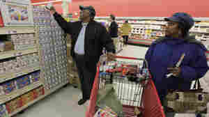 Melba Ware (right) and her husband, Herman, shop for food at a market in Chicago. A new report says American families need to earn  about $68,000 a year to achieve basic economic security — more than three times the national poverty line.